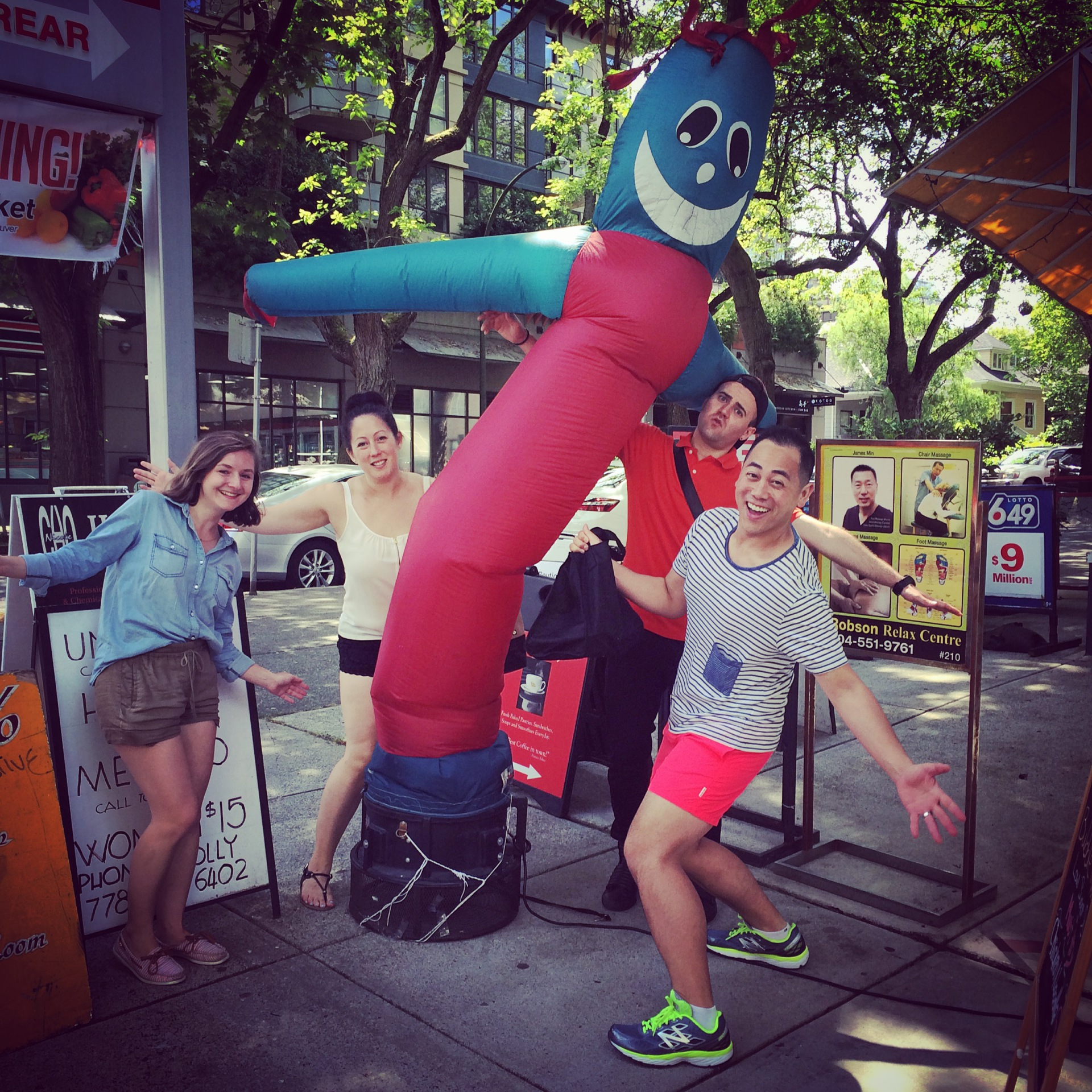 Taking a break during sidewalk brunch with this Wacky Inflatable Tube Man.