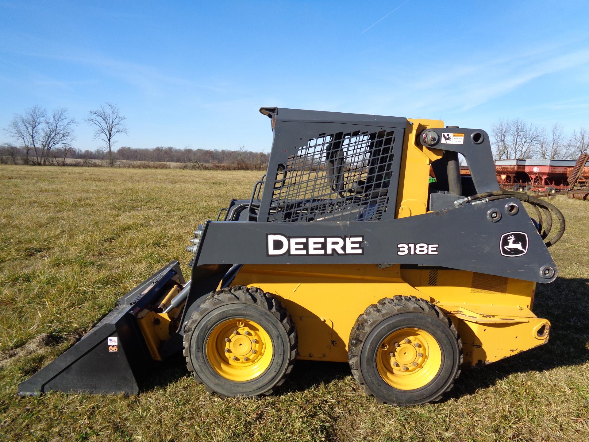 2014 Deere 318E     $20,900