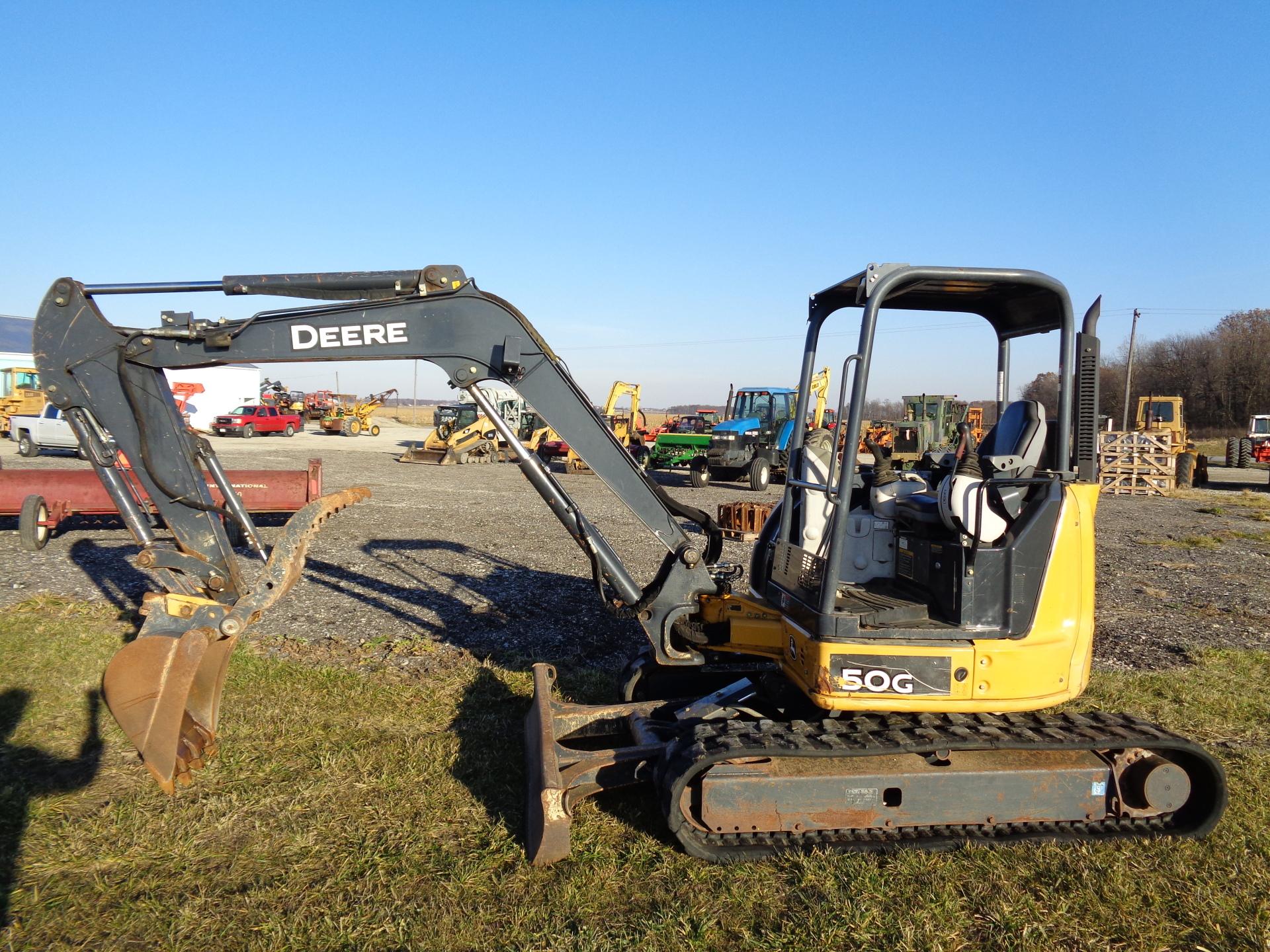 2013 Deere 50G     $34,900