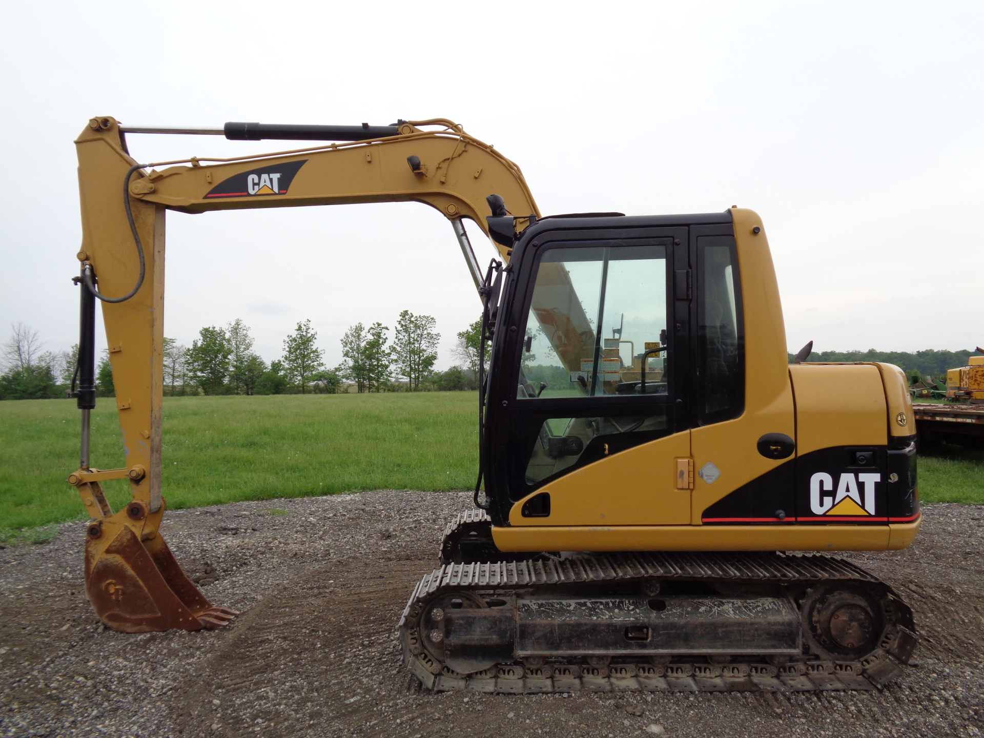 2003 Caterpillar 307C     $29,900