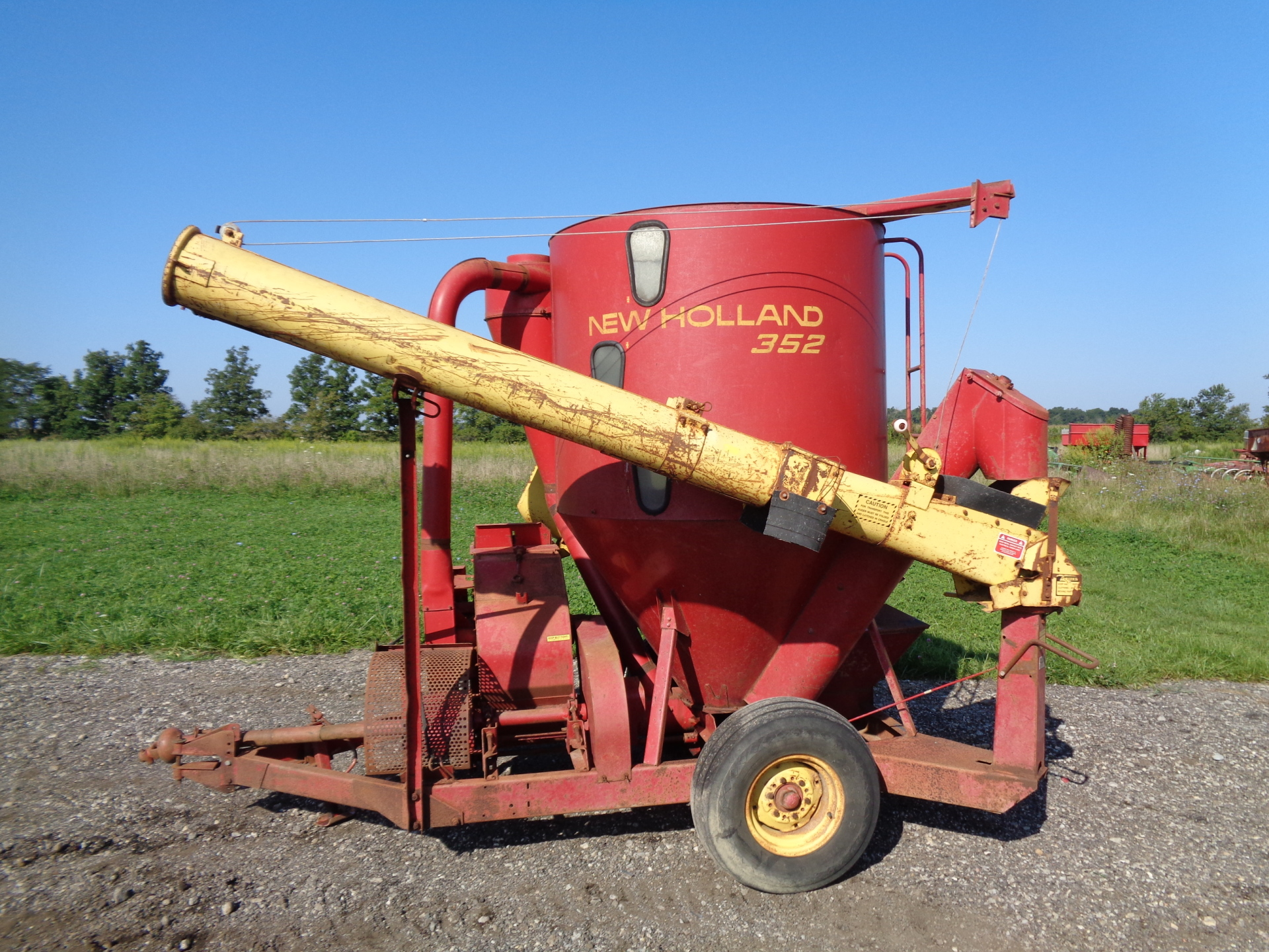 New Holland 352     $4,500