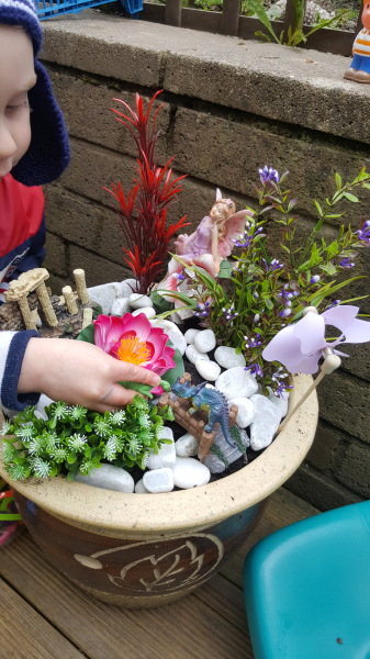 N introducing dinosaurs to the fairy theme small world outdooor play