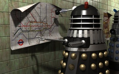 The Black Dalek looking at a London tube map