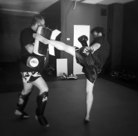 Pacific Muay Thai Instructor Britton Kicking pads