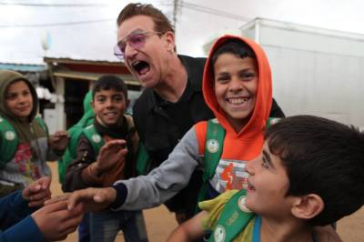 Bono Panics During Fire, Pushes Women, Children & the Elderly at Refugee Camp!