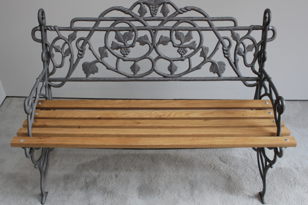 Cast iron and hardwood bench