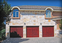Carriage House style Cedar garage doors with Mahogany stain.