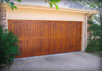 Carriage style Cedar garage doors with Butternut stain.