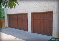 Carriage style Cedar garage doors with dark Oak stain.