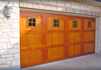 Carriage house Cedar garage door with Teak stain and square painted windows.