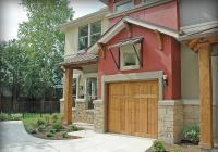 Cedar wood garage door with clear coat stain.