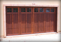 Cedar wood garage doors with Mahogany stain and square-paned windows.