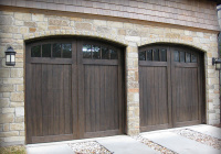 Cedar wood garage doors with arched windows and a customized stain.