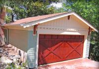 Cedar wood cross buck style garage door with a Cherry stain.