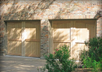Carriage style Cedar garage doors with a clear coat stain.