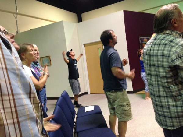 Students worshipping