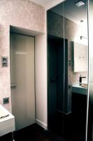 modern bathroom, glass countertop, rimadesio door