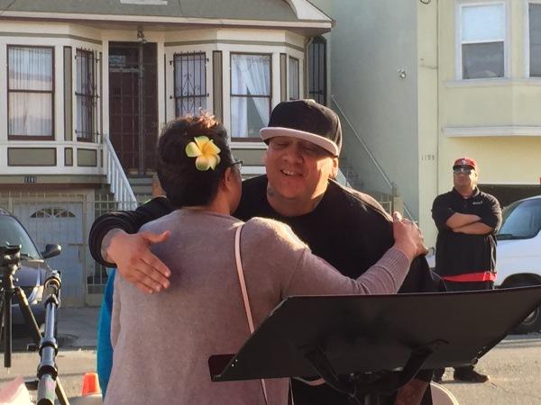 Pastor Shawn greets a member of the community
