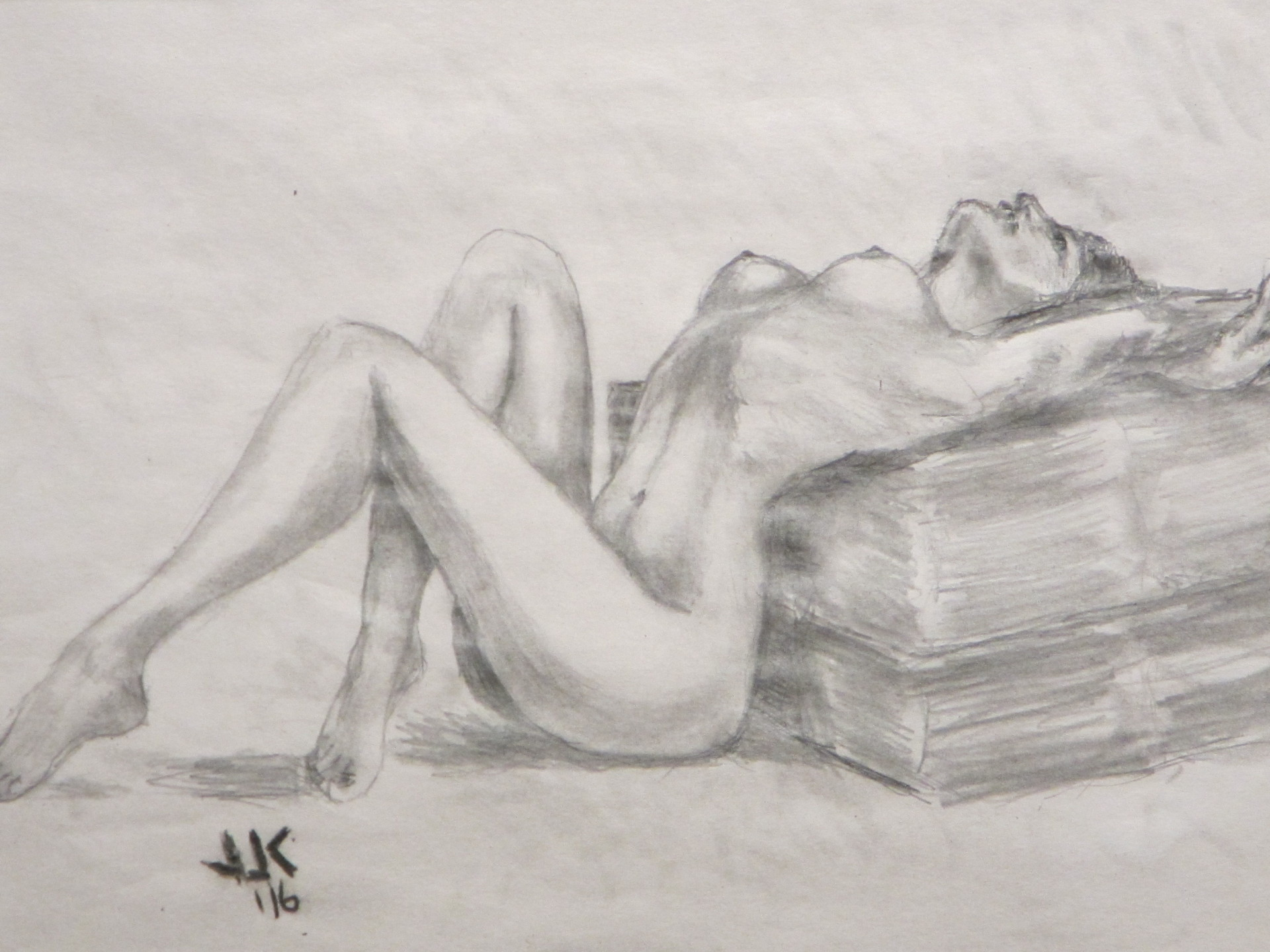 Pencil drawing of a nude woman stretching backwards over an ottoman.