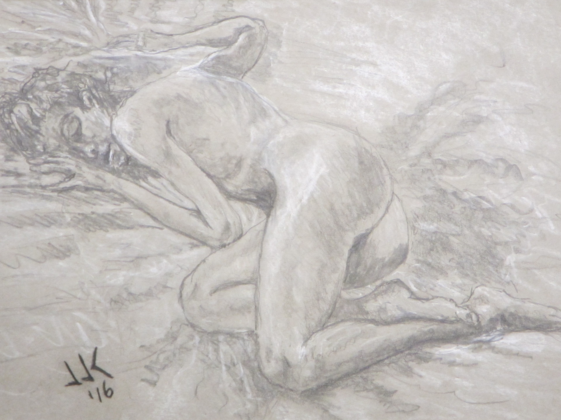 Pencil and white chalk pencil drawing on grey paper of a nude woman sleeping on a bed.