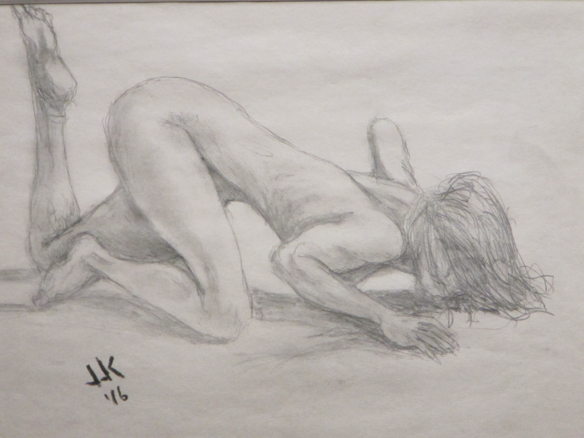 Pencil drawing of a nude woman on the floor in a seductive pose.