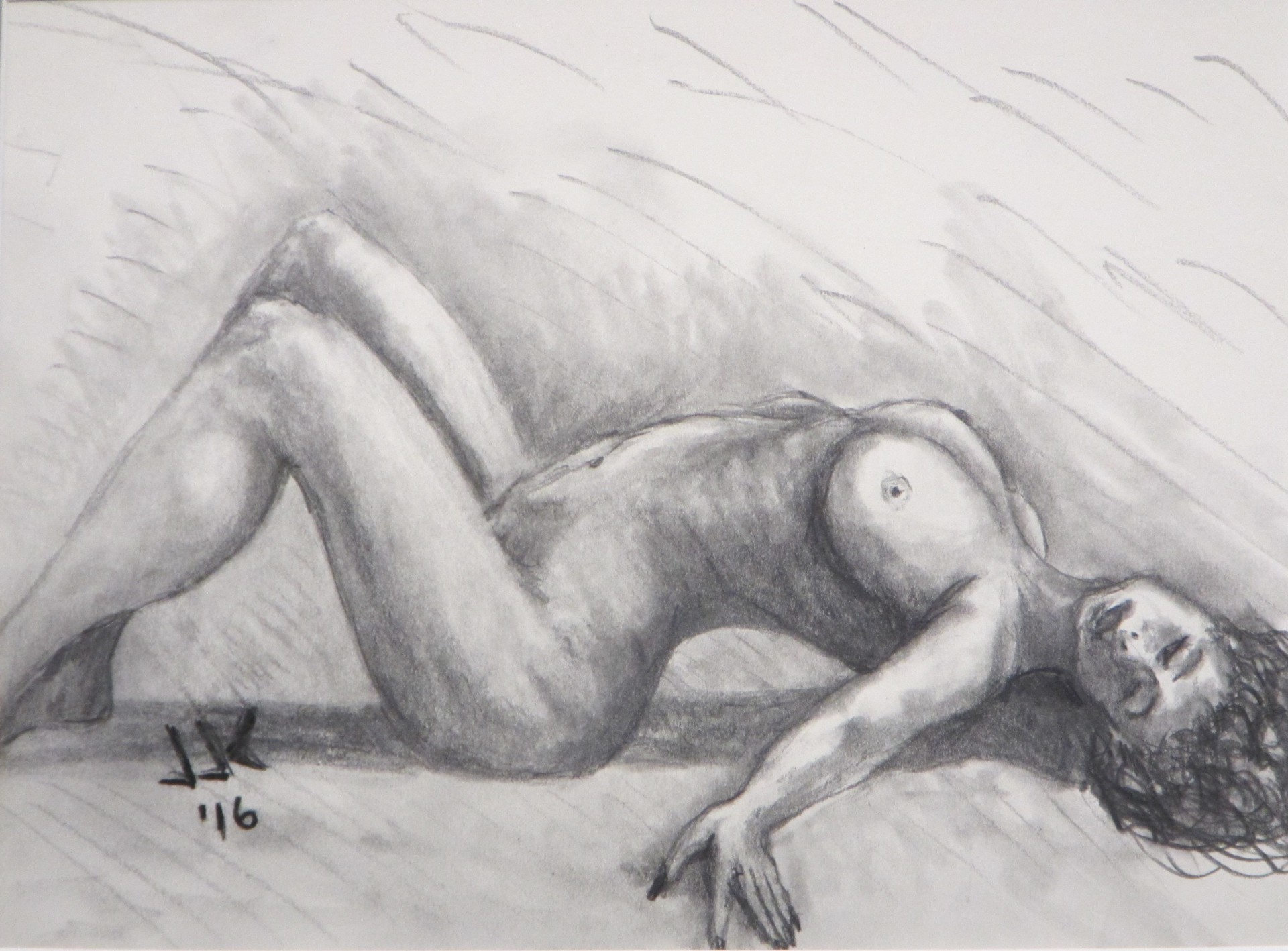 Pencil drawing of a nude woman lying on the floor and arching her back.