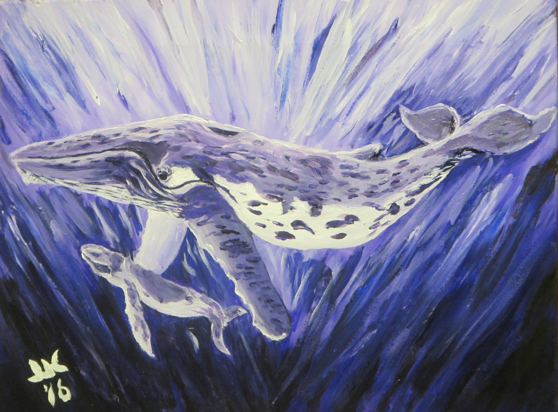 An undersea view of a humpback whale and her calf all in blue-violet.