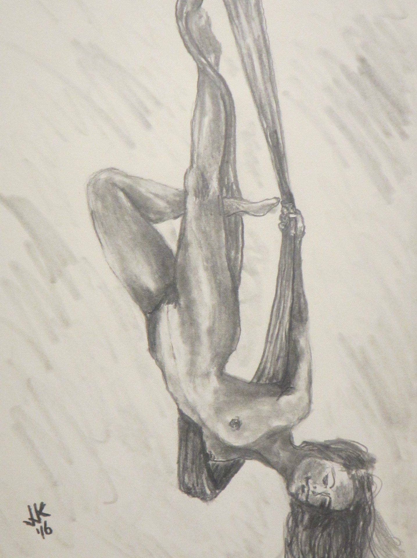 Nude woman swinging from drapes upside down.