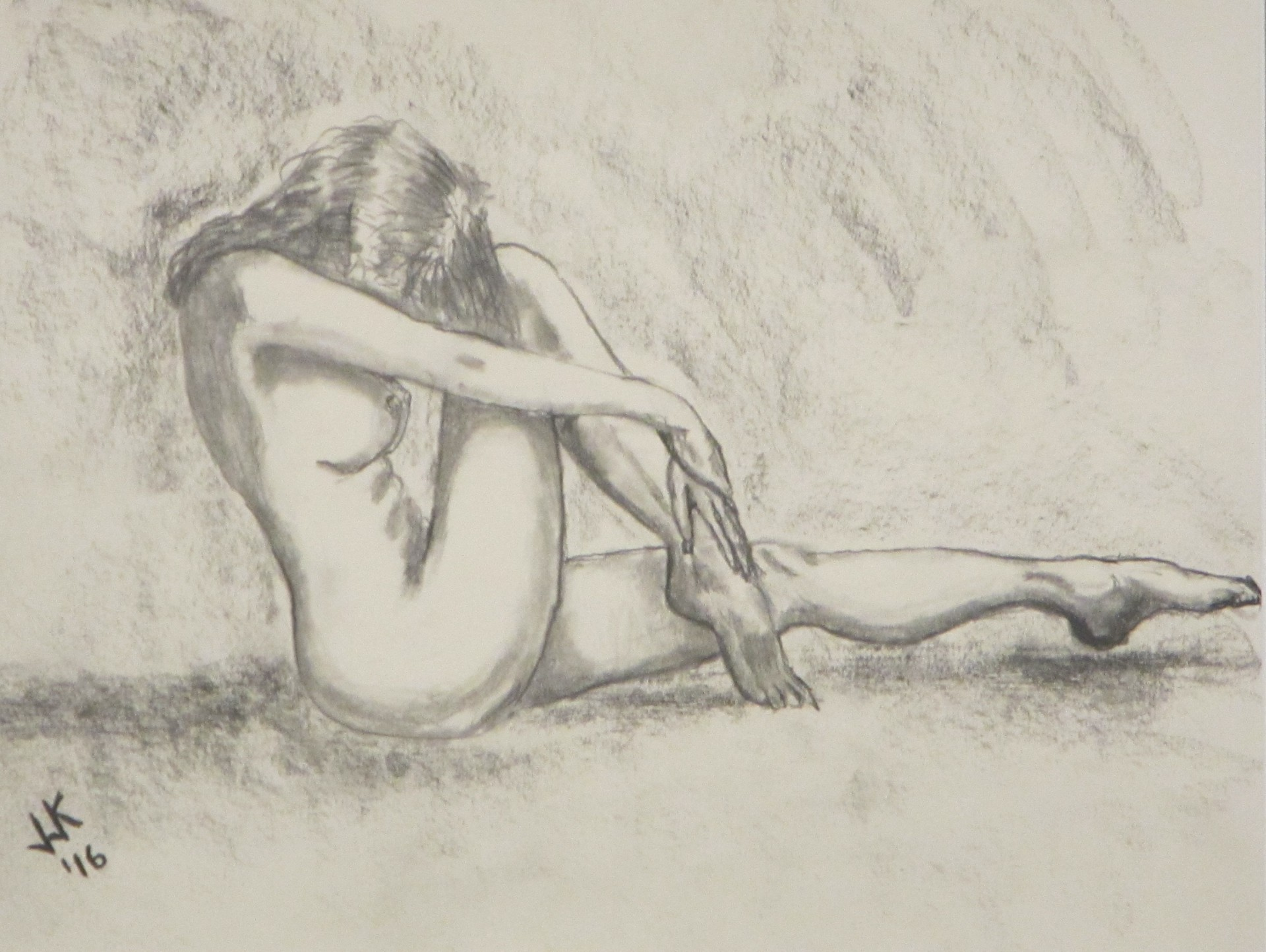 A nude woman acting coy.