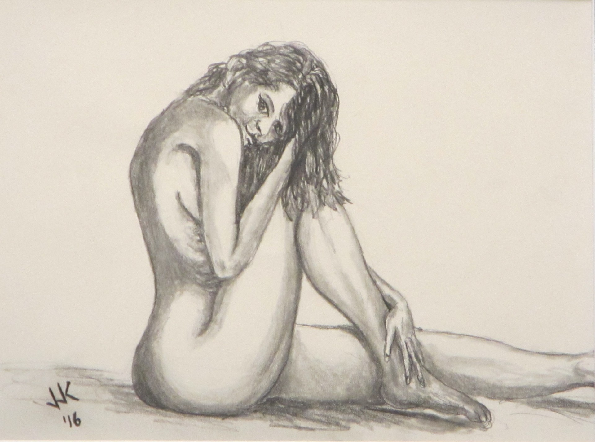 A nude, coquettish woman.