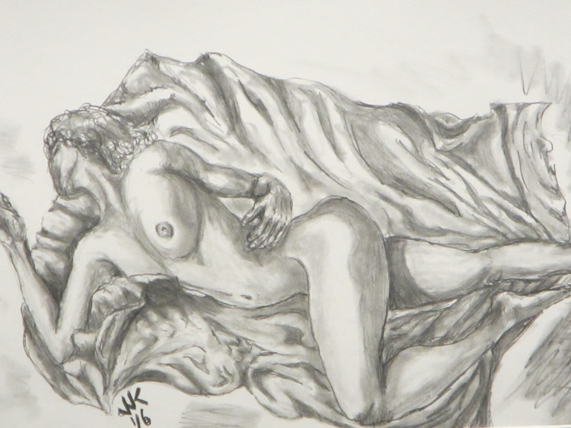 A nude woman lying on satin.