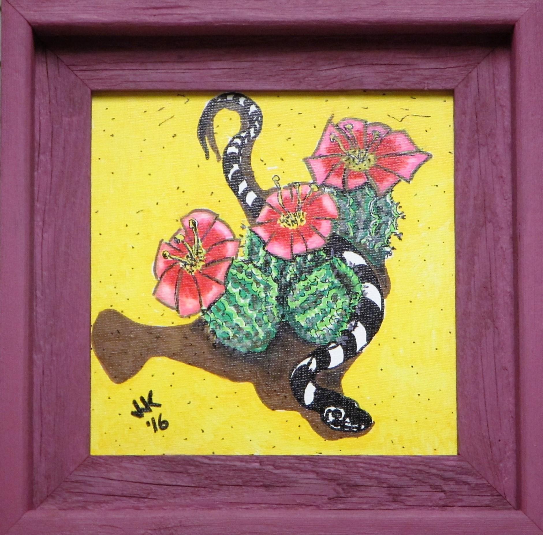 A desert king snake & some flowering cacti.
