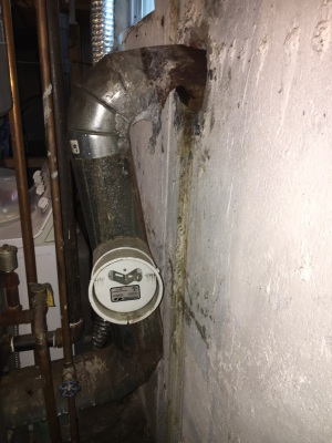Old Rusted Out Furnace Pipes Before