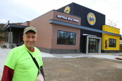Tom Howard, President of THC Inc. in front of Buffalo Wild Wings, Oneonta NY