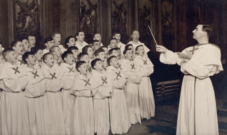 Arthur Oldham conducting the choir
