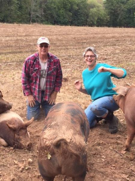 Rich, Nance and some of our pigs