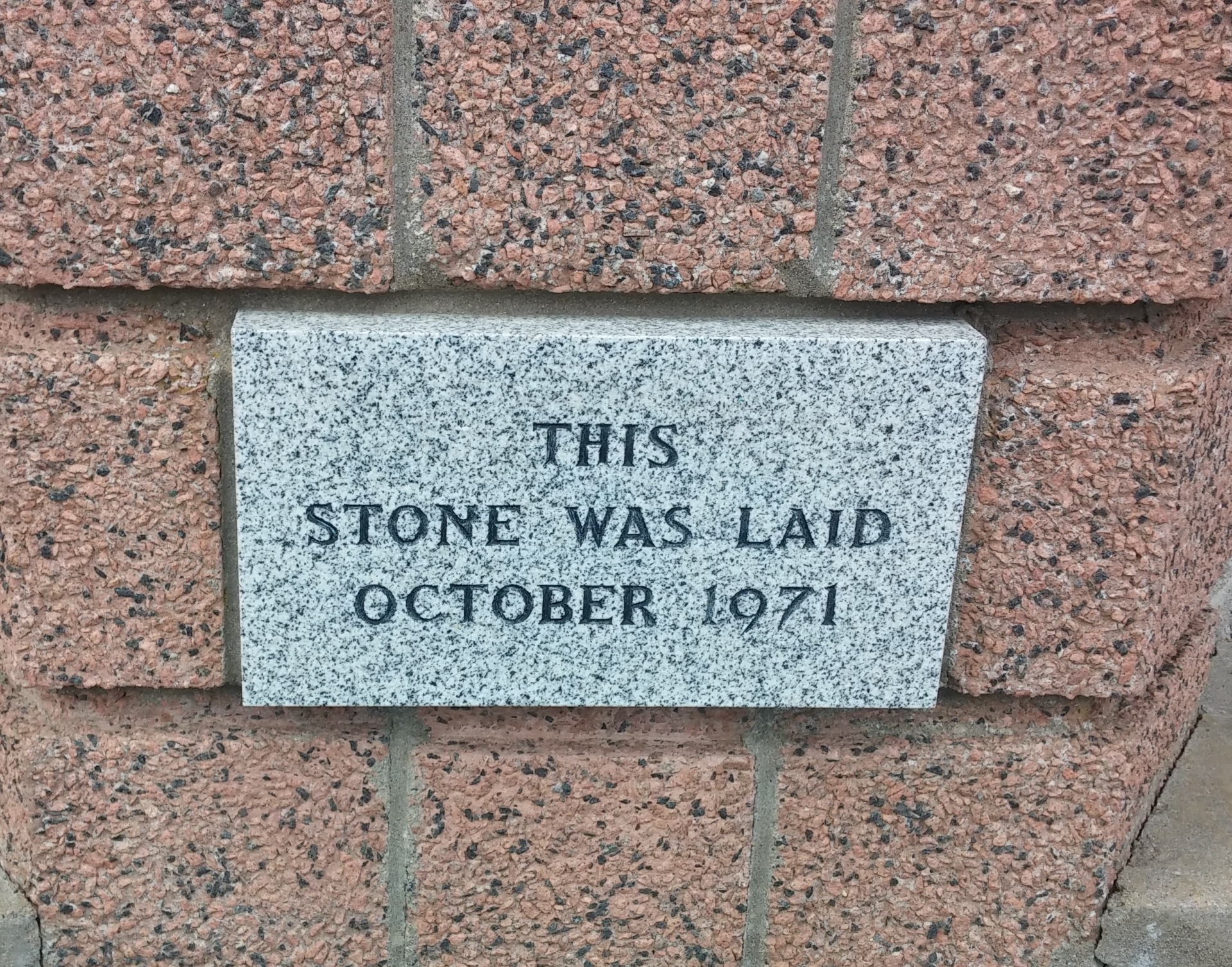 The Date Stone on original building