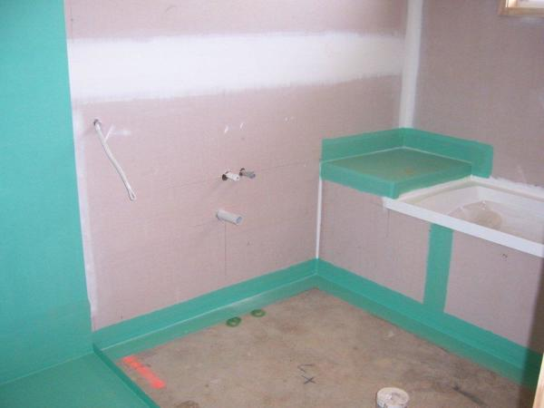 New bathroom showing waterproofing before tiles are laid