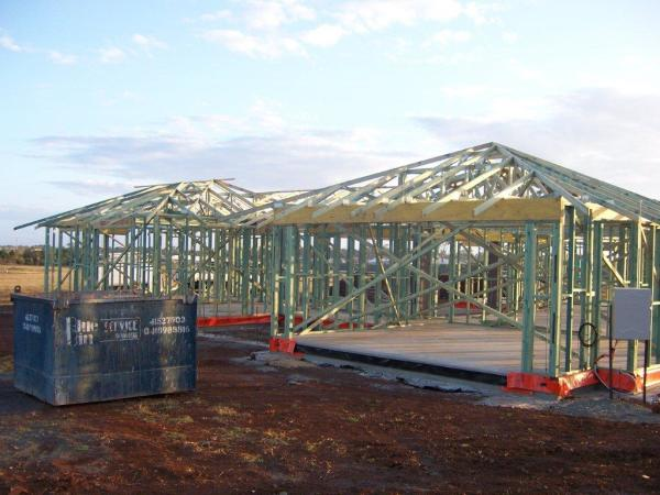 Timber framing for the new home is erected on the new concrete slab ready for closing in from the weather