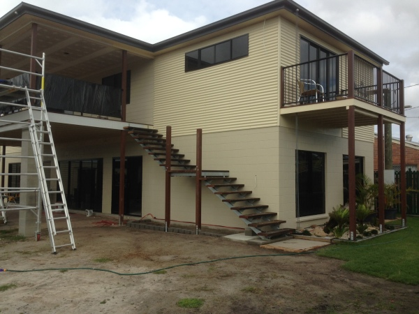 Final stages of finishing the exterior of the home