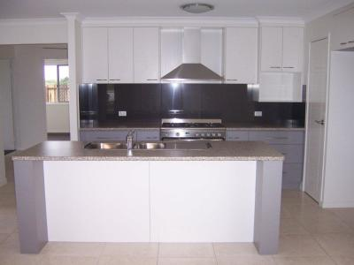 Renovated kitchen including new cabinetry, bench top, appliances and flooring