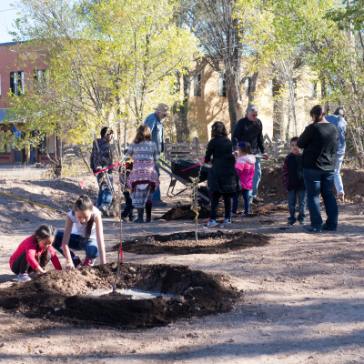 Community volunteers plant Monte Alto Plaza's orchard.