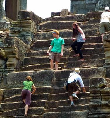 tourist climb takeo temple mountain