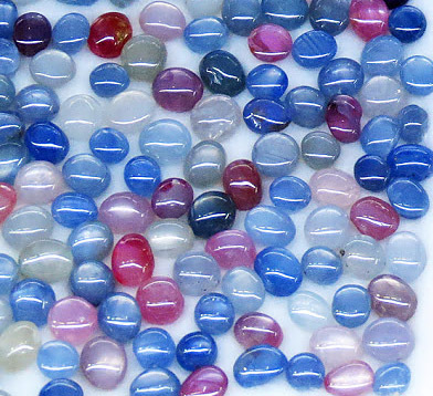 loose sapphire cabochon with various colors