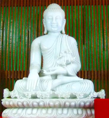Sitting white jade Buddha statue