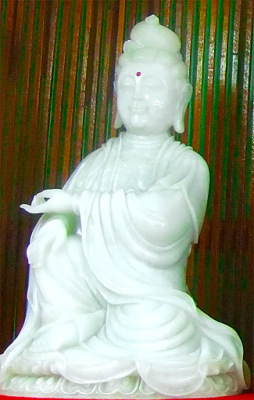 Sitting white jade statue