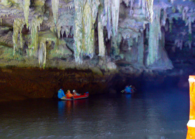 exploring the cave with the kayak