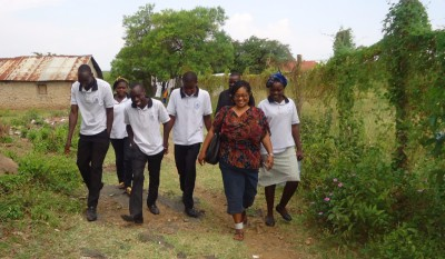Executive Director and Performing Arts Team walking to a performance