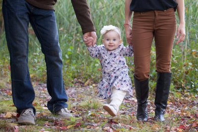 mom, dad walking with baby