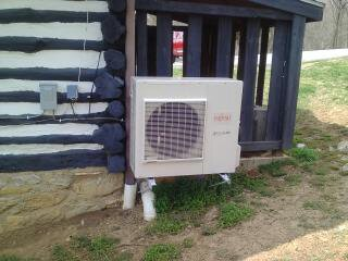 Fujitsu Ductless Outdoor Unit for Log Cabin, We install Fujisu  33 seer systems